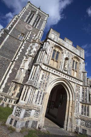 Church of St Edmund, Southwold, Suffolk, England, against a blue sky.