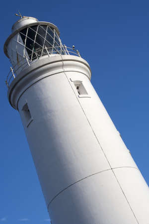 southwold: Southwold Lighthouse, Suffolk, England, against a blue sky. Stock Photo