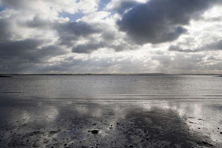 Grey clouds reflected in the sea