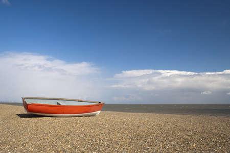 suffolk: Red fishing boat on Dunwich Beach in Suffolk, England