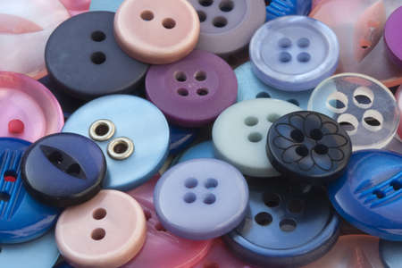 Closeup image of pink and blue sewing buttons