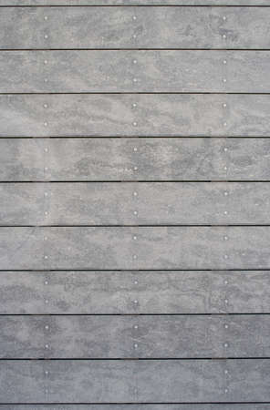 panelling: Close-up image of grey panelling with metal rivets