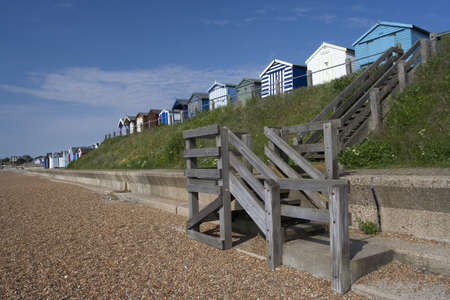 Steps and beach huts at Old Felixstowe, Suffolk , England photo
