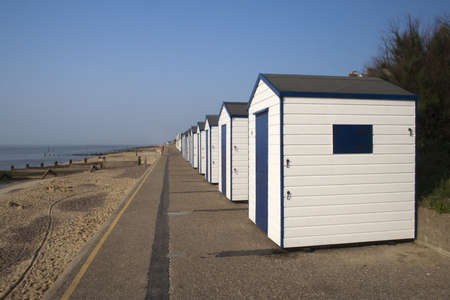 southwold: Blue and white beach huts against a blue sky at Southwold, Suffolk , England