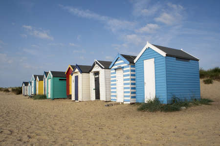 southwold: Colourful beach huts against a blue sky at Southwold, Suffolk , England