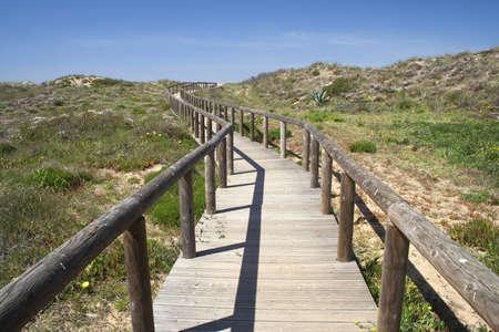 Wooden walkway leading to Bordeira Beach, Algarve, Portugal  Stock Photo
