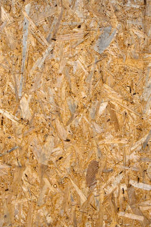 Closeup image showing the texture of chipboard