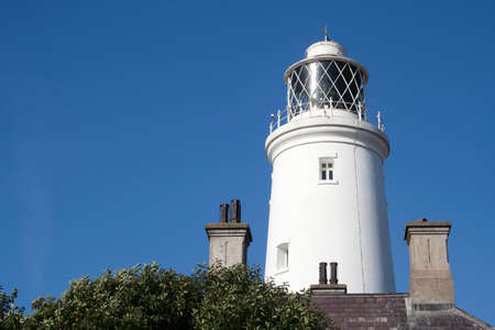 southwold: Southwold Lighthouse, Suffolk, England, against a blue sky