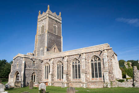 Church of St Andrew, Walberswick, Suffolk, England, against a blue sky Stock Photo