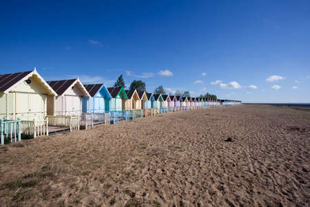 Colourful beach huts at West Mersea, Essex, England