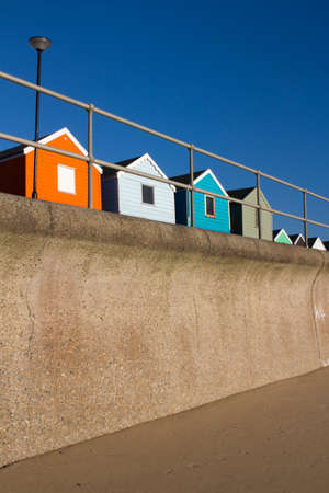 southwold: Colourful Beach Huts at Southwold, Suffolk , England,against a blue sky