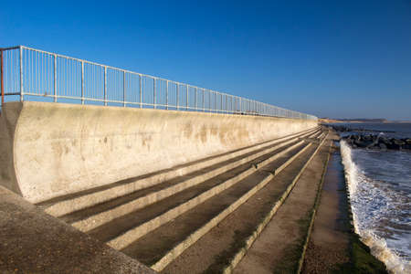 Sea wall and steps at Southwold, Suffolk , England. Stock Photo