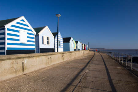 Beach huts at Southwold, Suffolk , England, against a blue sky photo