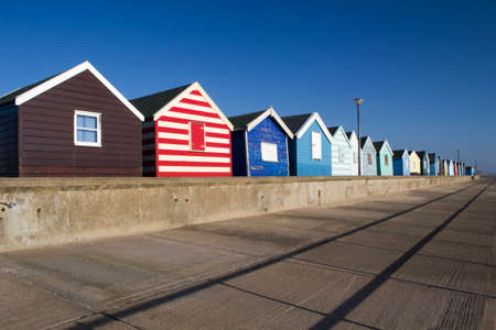 Colourful Beach Huts at Southwold, Suffolk , England,against a blue sky photo