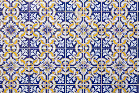 Background of traditional blue, white and gold portuguese tiles