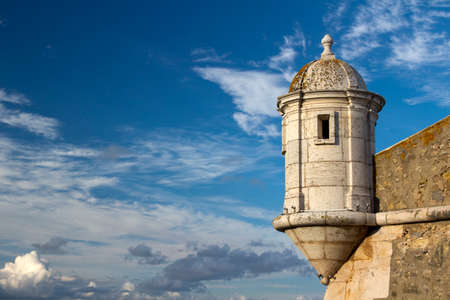 Tower of the ancient fort in Lagos, Algarve, Portugal, against a blue sky