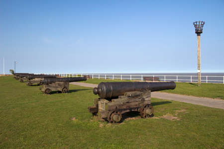 southwold: Cannons on Gun Hill, Southwold, Suffolk, England  Europe, against a blue sky
