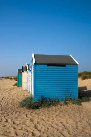 southwold: Beach huts against a blue sky at Southwold, Suffolk , England