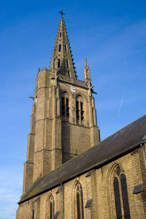 The Church of Saint Leger, Socx, northern France, against a blue sky