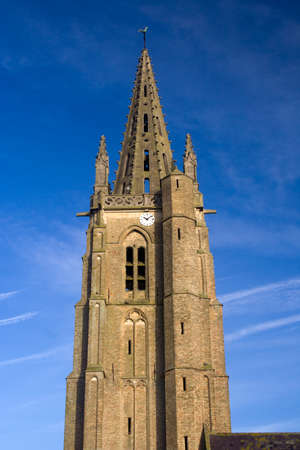 spire: The spire of Saint Leger church, Socx, northern France, against a blue sky Stock Photo