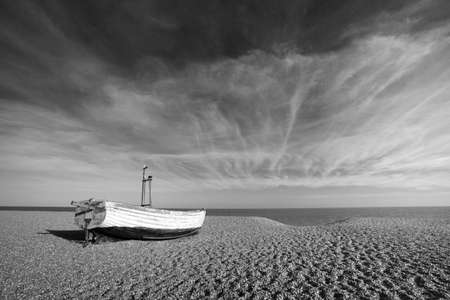 Black and white image of a fishing boat on Aldeburgh Beach in Suffolk, England