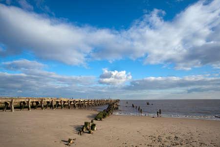 groyne: Harbour wall and groyne on Walberswick beach Suffolk, England