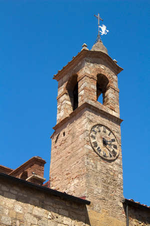 Tower of Bibbona Church, Tuscany, Italy, against a blue sky