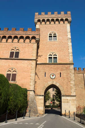 Bolgheri Castle, Tuscany, Italy, against a blue sky