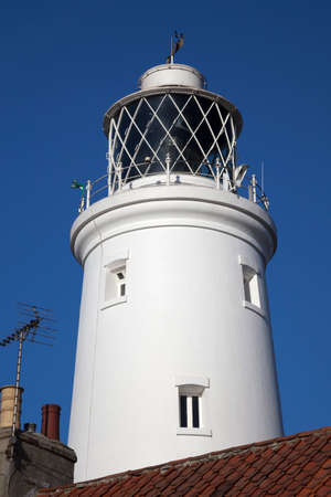Southwold Lighthouse, Suffolk, England, against a blue sky. Stock Photo