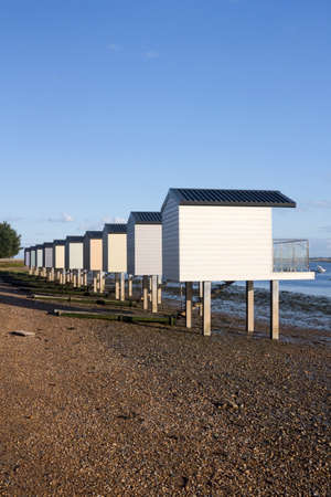Pastel coloured beach huts at Heybridge, Essex, England Stock Photo