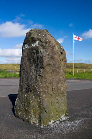 English flag and rock with England painted on it, marking the Scottish - English Border, Northumberland, United Kingdom