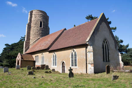 All Saints Church, Ramsholt, Suffolk, England, against a blue sky Stock Photo