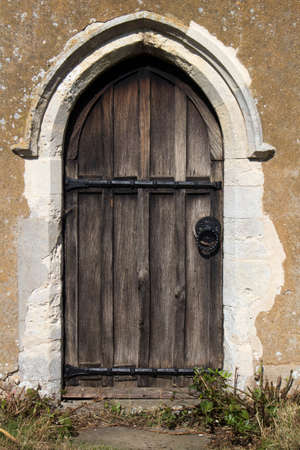 Old wooden door of Ramsholt church, Ramsholt, Suffolk, England Stock Photo