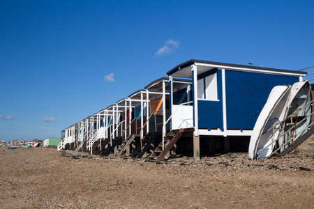 Beach huts and boats on Thorpe Bay beach, near Southend, Essex, England