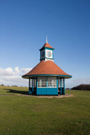 Clock tower and shelter on the greensward at Frinton-on-Sea, Essex, England