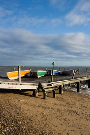 Colourful boats on Jubilee Beach, Southend-on-Sea, Essex, England