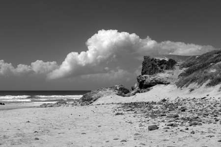 Black and white image of Cordama Beach, on the west coast of the Algarve, Portugal