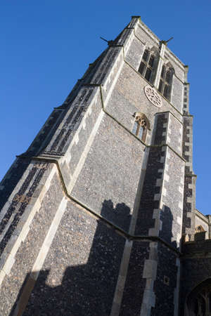 Church of St Edmund, Southwold, Suffolk, England, against a blue sky.