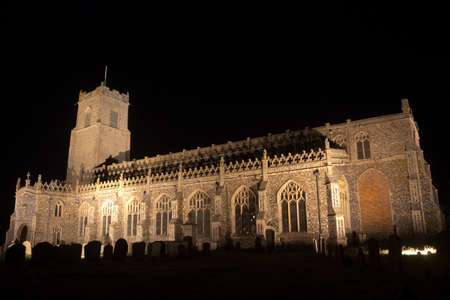 Holy Trinity Church, Blythburgh, Suffolk, England, floodlit at night