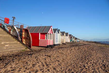 Boats and beach huts on Thorpe Bay beach, near Southend-on-Sea, Essex, England