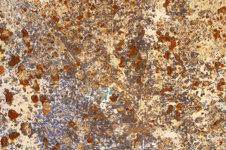 Closeup image showing the textures and colours of rust and peeling paint