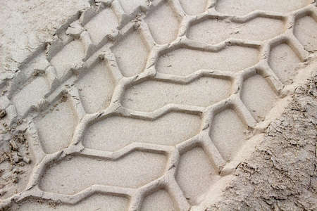 Close-up image showing the texture of tyre marks in the sand