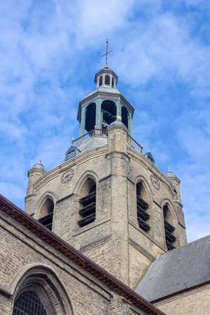 Bell tower of the Saint-Jean-Baptiste Church, Bourbourg , France, against a blue sky Stock Photo