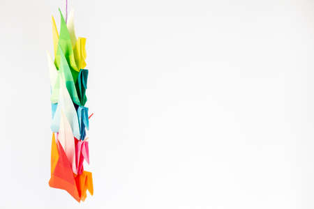 Colourful origami birds against a white background, with space for text