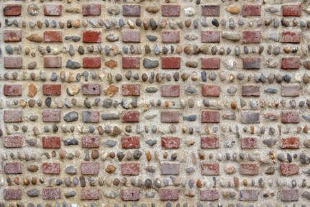 Close-up image of a brick and pebble wall Stock Photo