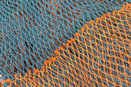 Green and orange fishing nets Stock Photo