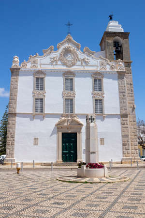 Church of Nossa Senhora do Rosario, Olhao, Algarve, Portugal, against a blue sky