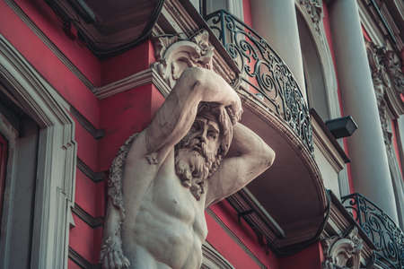 An old stucco face of a man with a beard on the building in Saint-Petersburg, Russia