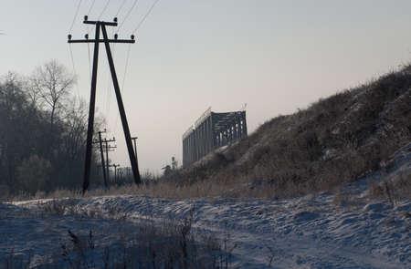 Winter landscape with a railway bridge is a good screensaver. 版權商用圖片