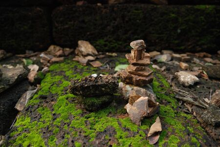 stack stones: stack stones arounded with moss